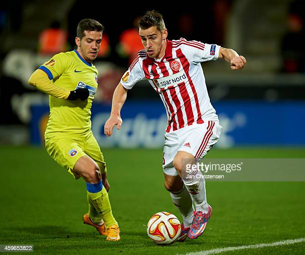 Donny Gorter of AaB Aalborg compete for the ball during the UEFA Europa Liga match between AaB Aalborg and Steaua Bukarest at Nordjyske Arena on...