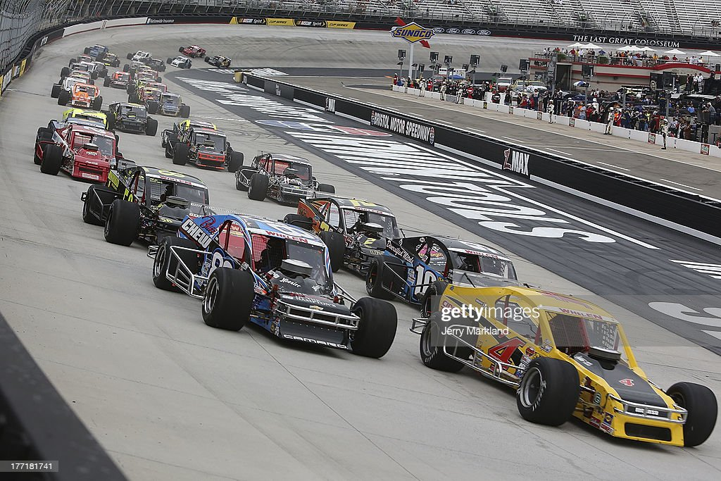 Donny Lia, driver of the #4 Circle Track Magazine Dodge leads a group of cars at the start of the NASCAR Whelen Modified Titan Roof 150 at Bristol Motor Speedway on August 21, 2013 in Bristol, Tennessee.