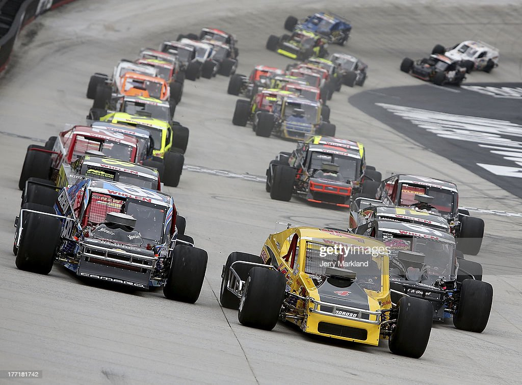 Donny Lia, driver of the #4 Circle Track Magazine Dodge leads a group of cars during the NASCAR Whelen Modified Titan Roof 150 at Bristol Motor Speedway on August 21, 2013 in Bristol, Tennessee.