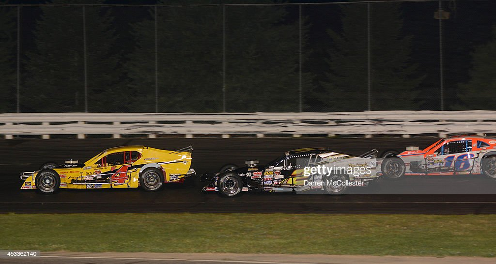 Donny Lia driver of the #4 Mystic Missile Racing Dodge leads Doug Coby driver of the #2 Dunleavy's Repair/HEX Performance Chevrolet and Ryan Preece driver of the #16 East West Marine/Diversified Metals Ford at the Call Before You Dig 811 150 at Stafford Motor Speedway August 8, 2014 in Stafford, Connecticutt.