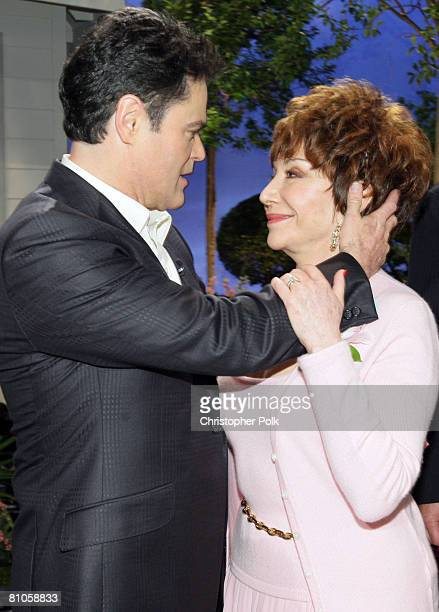 CULVER CITY CA MAY 11 Donny Osmond and Lynda Resnick during 'Teleflora presents America's Favorite Mom' in Culver City on May 10 2008 Pasadena CA...