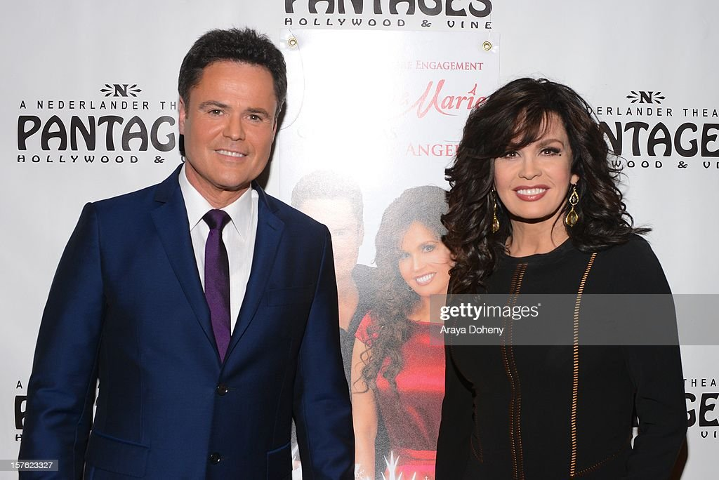 <a gi-track='captionPersonalityLinkClicked' href=/galleries/search?phrase=Donny+Osmond&family=editorial&specificpeople=214564 ng-click='$event.stopPropagation()'>Donny Osmond</a> and <a gi-track='captionPersonalityLinkClicked' href=/galleries/search?phrase=Marie+Osmond&family=editorial&specificpeople=217477 ng-click='$event.stopPropagation()'>Marie Osmond</a> arrive at the 'Donny & Marie Christmas In Los Angeles' - Opening Night Performance at the Pantages Theatre on December 4, 2012 in Hollywood, California.