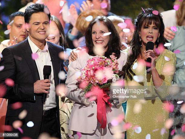 CULVER CITY CA MAY 11 Donny Osmond winner Patti PattonBader Military Mom and Marie Osmond during Teleflora presents America's Favorite Mom in Culver...