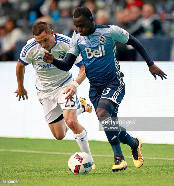 Donny Toia of the Montreal Impact and Kekuta Manneh of the Vancouver Whitecaps chase a loose ball during their MLS game March 6 2016 at BC Place in...
