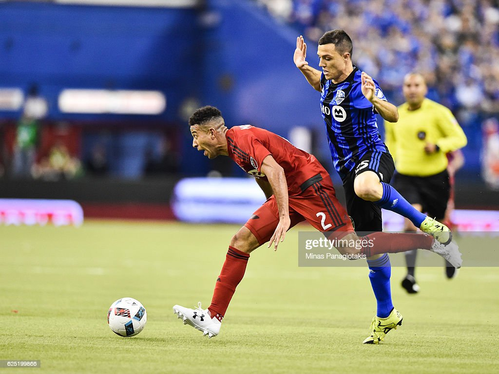 Donny Toia #25 of the Montreal Impact challenges Justin Morrow #2 of the Toronto FC during leg one of the MLS Eastern Conference finals at Olympic Stadium on November 22, 2016 in Montreal, Quebec, Canada. The Montreal Impact defeated the Toronto FC