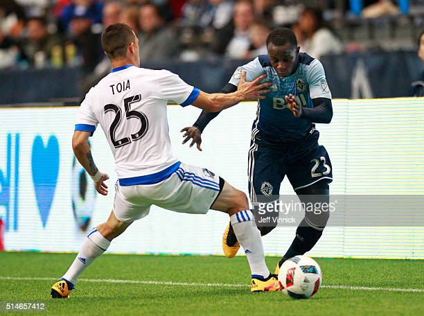 Donny Toia of the Montreal Impact defends against Kekuta Manneh of the Vancouver Whitecaps during their MLS game March 6 2016 at BC Place in...