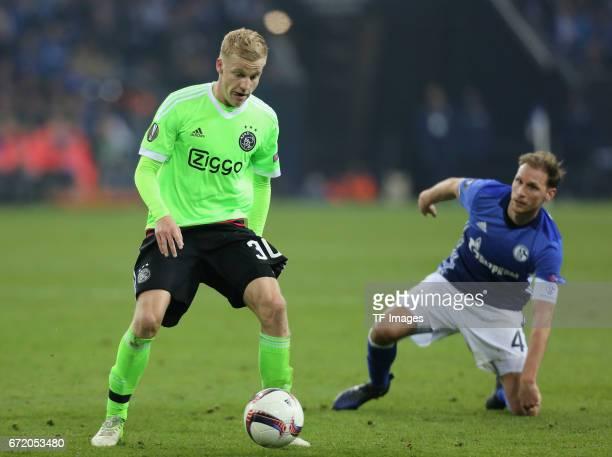 Donny van de Beek of Ajax Amsterdam and Benedikt Hoewedes of Schalke battle for the ball during the UEFA Europa League quarter final second leg match...