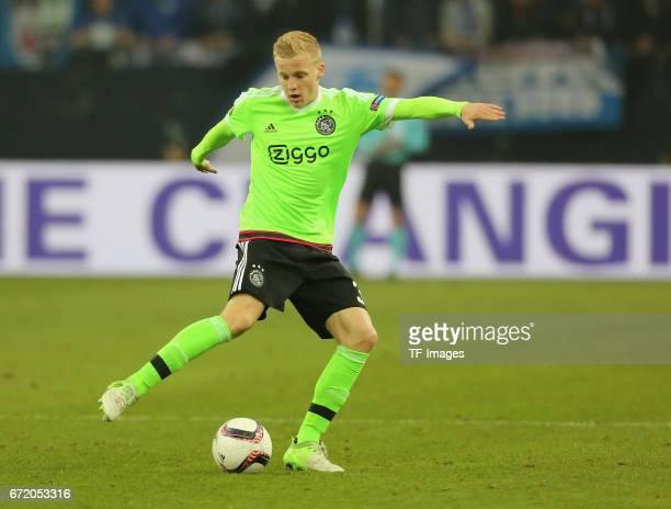 Donny van de Beek of Ajax Amsterdam controls the ball during the UEFA Europa League quarter final second leg match between FC Schalke 04 and Ajax...
