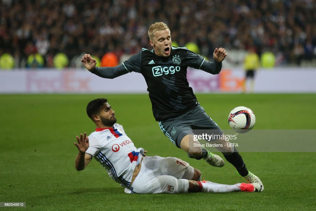 Donny van de Beek of Ajax Amsterdam is tackled by Nabil Fekir of Olympique Lyonnais during the Uefa Europa League, semi final second leg match, between Olympique Lyonnais Lyon and Ajax Amsterdam at Parc Olympique on May 11, 2017 in Lyon, France.