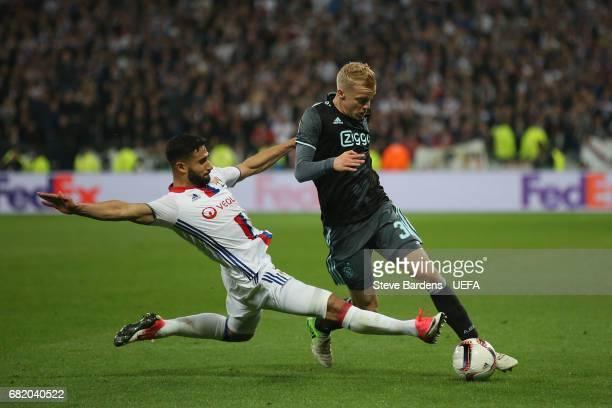 Donny van de Beek of Ajax Amsterdam is tackled by Nabil Fekir of Olympique Lyonnais during the Uefa Europa League semi final second leg match between...