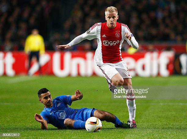 Donny van de Beek of Ajax battles for the ball with Etzaz Hussain of Molde FK during the group A UEFA Europa League match between AFC Ajax and Molde...