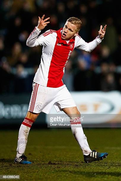 Donny Van De Beek of Ajax celebrates scoring his penalty in the shoot out during the UEFA Youth League Round of 16 match between Ajax Amsterdam and...
