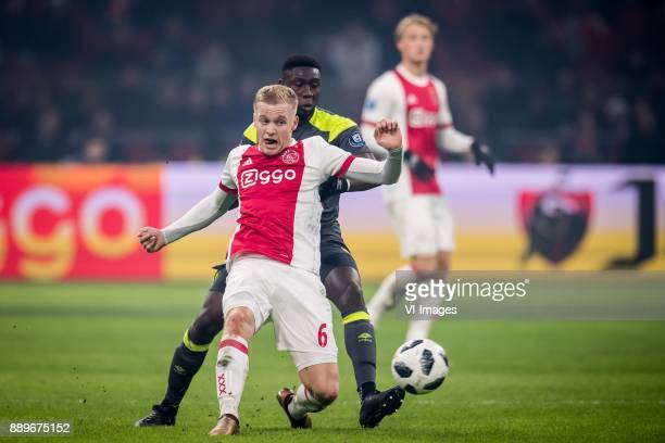 Donny van de Beek of Ajax Derrick Luckassen of PSV during the Dutch Eredivisie match between Ajax Amsterdam and PSV Eindhoven at the Amsterdam Arena...