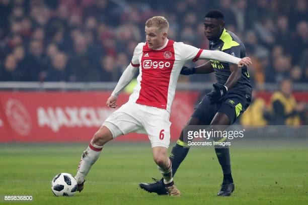 Donny van de Beek of Ajax Derrick Luckassen of PSV during the Dutch Eredivisie match between Ajax v PSV at the Johan Cruijff Arena on December 10...
