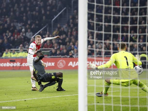 Donny van de Beek of Ajax Derrick Luckassen of PSV goalkeeper Jeroen Zoet of PSV 30 during the Dutch Eredivisie match between Ajax Amsterdam and PSV...