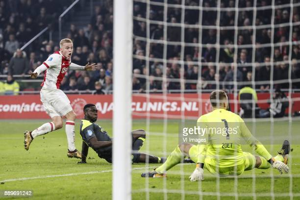 Donny van de Beek of Ajax Derrick Luckassen of PSV goalkeeper Jeroen Zoet of PSV during the Dutch Eredivisie match between Ajax Amsterdam and PSV...