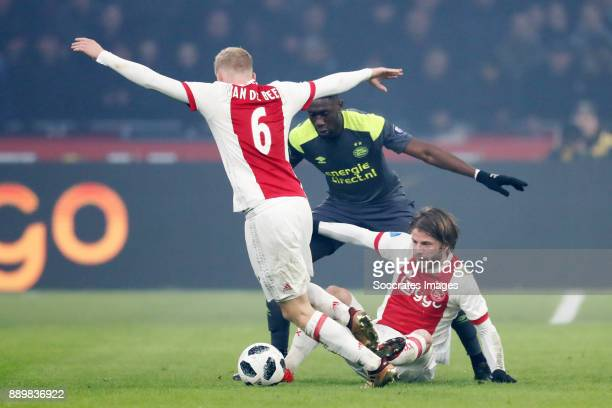Donny van de Beek of Ajax Derrick Luckassen of PSV Lasse Schone of Ajax during the Dutch Eredivisie match between Ajax v PSV at the Johan Cruijff...