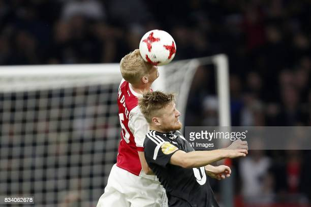 Donny van de Beek of Ajax Fredrik Midtsjo of Rosenborg BK during the UEFA Europa League fourth round qualifying first leg match between Ajax...
