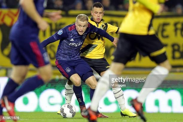 Donny van de Beek of Ajax Giovanni Korte of NAC Breda during the Dutch Eredivisie match between NAC Breda and Ajax Amsterdam at the Rat Verlegh...