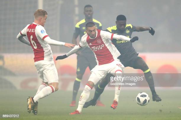 Donny van de Beek of Ajax Hakim Ziyech of Ajax Derrick Luckassen of PSV during the Dutch Eredivisie match between Ajax v PSV at the Johan Cruijff...