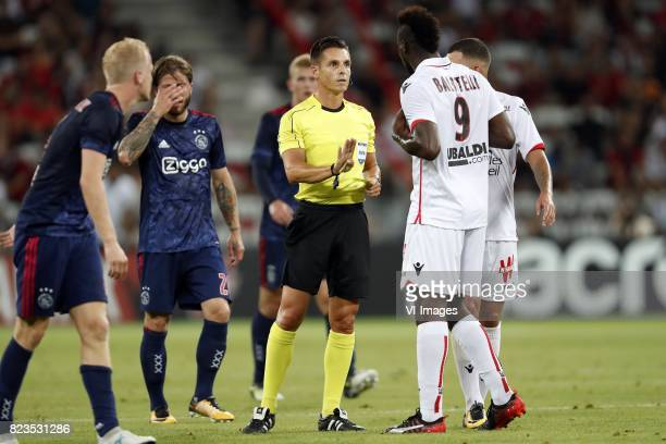 Donny van de Beek of Ajax Lasse Schone of Ajax Matthijs de Ligt of Ajax referee Carlos Del Cerro Mario Balotelli of OCG Nice during the UEFA...