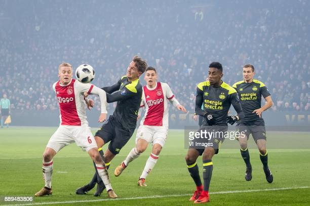 Donny van de Beek of Ajax Luuk de Jong of PSV Maximilian Max Wober of Ajax Joshua Brenet of PSV Daniel Schwaab of PSV during the Dutch Eredivisie...