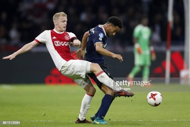 Donny van de Beek of Ajax Ryan Sanusi of Sparta Rotterdam during the Dutch Eredivisie match between Ajax Amsterdam and Sparta Rotterdam at the...