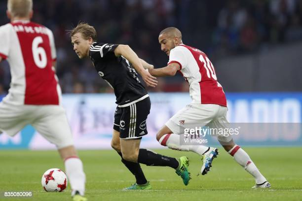 Donny van de Beek of Ajax YannErik de Lanlay of Rosenborg BK Hakim Ziyech of Ajax during the UEFA Europa League fourth round qualifying first leg...