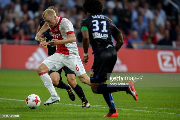 Donny van den Beek from AJAX shadowed by Bonfim Dante from OSC Nice during the UEFA Champions League Qualifying Third Round Second Leg match between...