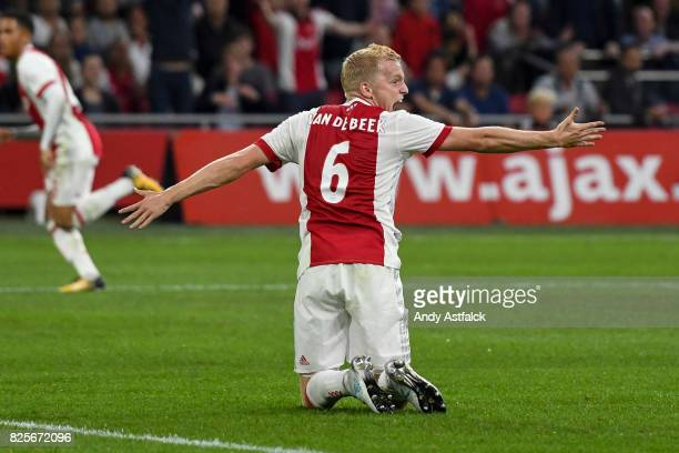Donny van den Beek of AJAX reacts during the UEFA Champions League Qualifying Third Round Second Leg match between AJAX Amsterdam and OSC Nice at...