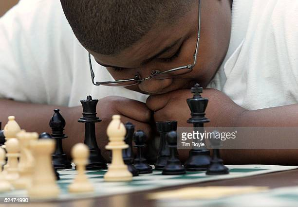 Donovan Harris twelveyearsold studies a move as he practices prior to competing in the Chicago Public School City Chess Championship at the Harold...