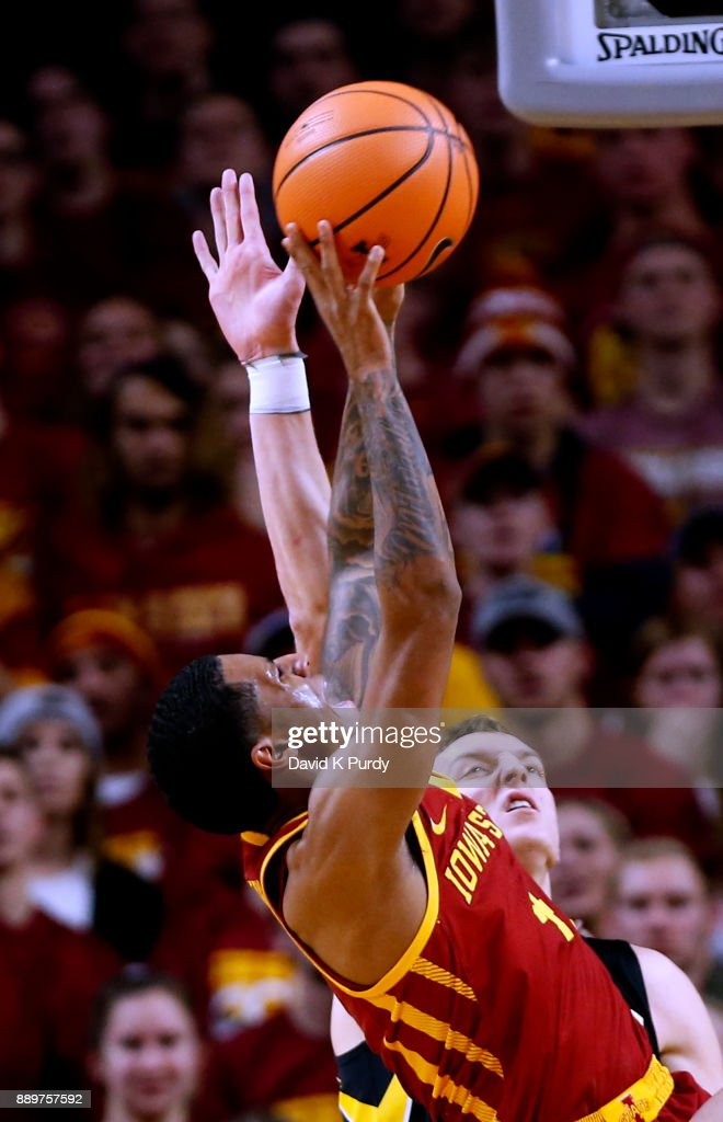 Donovan Jackson #4 of the Iowa State Cyclones takes a shot as Jack Nunge #2 of the Iowa Hawkeyes blocks in the second half of play at Hilton Coliseum on December 7, 2017 in Ames, Iowa. The Iowa State Cyclones won 84-78 over the Iowa Hawkeyes.