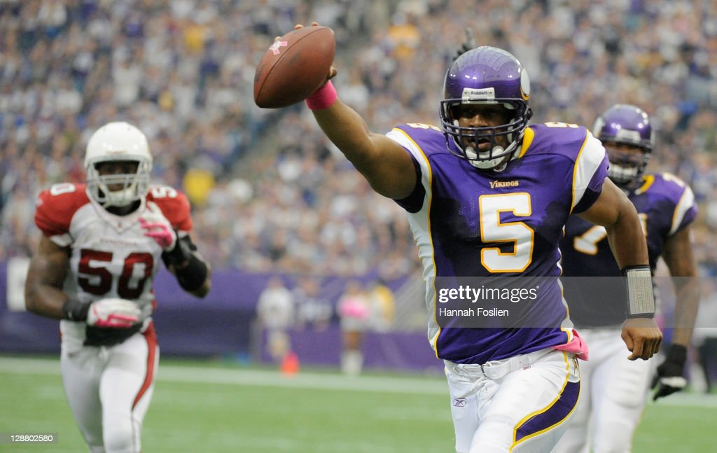 Donovan McNabb #5 of the Minnesota Vikings celebrates as he carries the ball for a touch down against the Arizona Cardinals in the first quarter on October 9, 2011 at Hubert H. Humphrey Metrodome in Minneapolis, Minnesota.