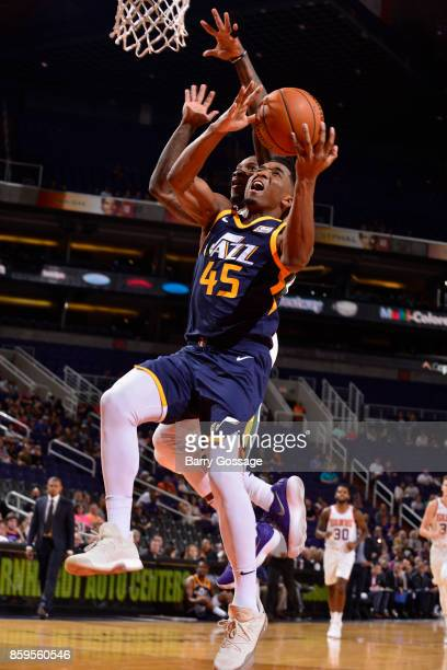 Donovan Mitchell of the Utah Jazz goes to the basket against the Phoenix Suns on October 9 2017 at Talking Stick Resort Arena in Phoenix Arizona NOTE...
