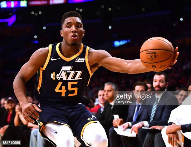 Donovan Mitchell of the Utah Jazz grabs a rebound during the game against the Los Angeles Lakers at Staples Center on October 10 2017 in Los Angeles...
