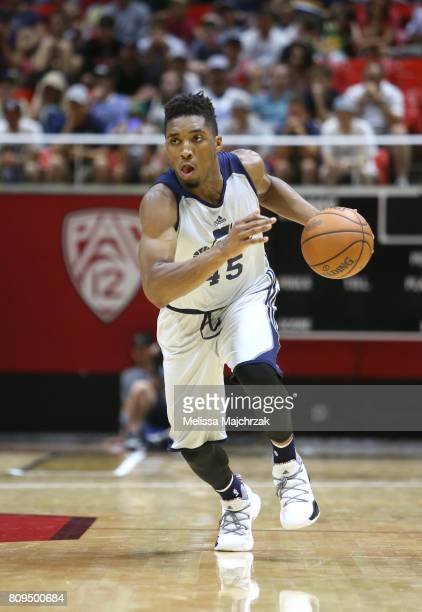 Donovan Mitchell of the Utah Jazz handles the ball against the Philadelphia 76ers on July 5 2017 during the 2017 NBA Utah Summer League game at the...