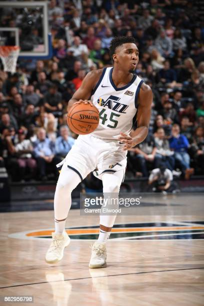 Donovan Mitchell of the Utah Jazz handles the ball against the Denver Nuggets during the game on October 18 2017 at vivintSmartHome Arena in Salt...