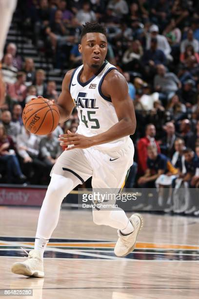 Donovan Mitchell of the Utah Jazz handles the ball during a game against the Oklahoma City Thunder on October 21 2017 at Vivint Smart Home Arena in...