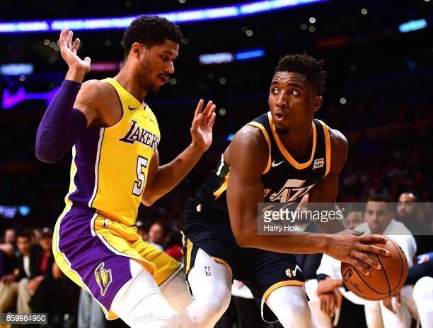 Donovan Mitchell of the Utah Jazz looks to pass around Josh Hart of the Los Angeles Lakers during a 10599 Jazz win at Staples Center on October 10...