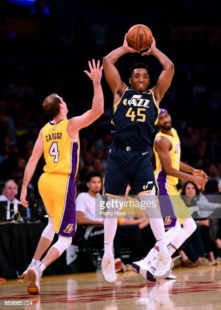 Donovan Mitchell of the Utah Jazz makes a pass in front of Alex Caruso of the Los Angeles Lakers during a 10599 Jazz win at Staples Center on October...