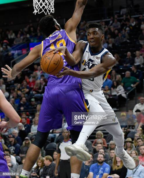 Donovan Mitchell of the Utah Jazz passes around Amritpal Singh of the Sydney Kings in the first half of their preseason game at Vivint Smart Home...