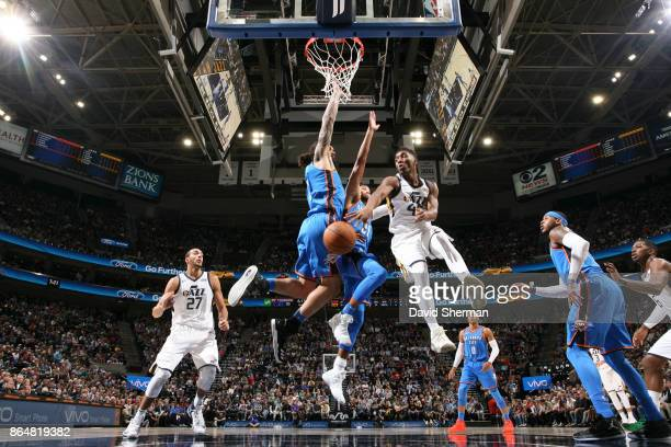 Donovan Mitchell of the Utah Jazz passes the ball during a game against the Oklahoma City Thunder on October 21 2017 at Vivint Smart Home Arena in...