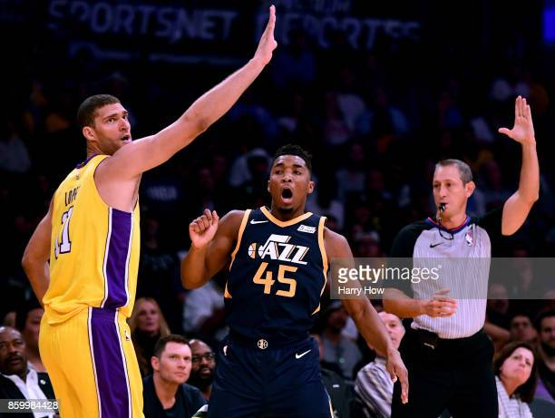 Donovan Mitchell of the Utah Jazz reacts to his three pointer in front of Brook Lopez of the Los Angeles Lakers during the fourth quarter in a 10599...