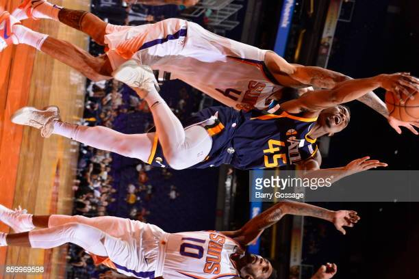 Donovan Mitchell of the Utah Jazz shoots the ball during the preseason game against the Phoenix Suns on October 9 2017 at Talking Stick Resort Arena...