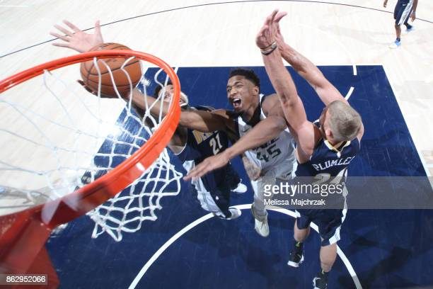 Donovan Mitchell of the Utah Jazz shoots the ball during the season game against the Denver Nuggets on October 18 2017 at Vivint Smart Home Arena in...