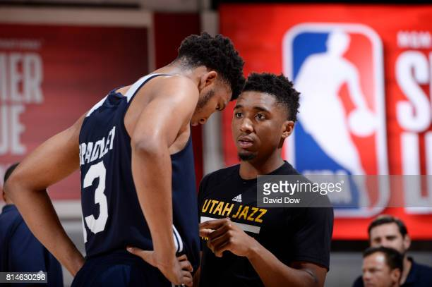 Donovan Mitchell of the Utah Jazz speaks with Tony Bradley during the game against the Milwaukee Bucks during the 2017 Summer League on July 14 2017...