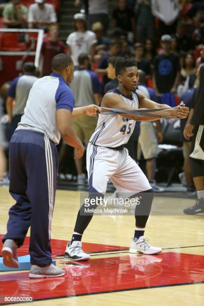 Donovan Mitchell of the Utah Jazz stretches before the game against the San Antonio Spurs on July 3 2017 at Jon M Huntsman Center in Salt Lake City...