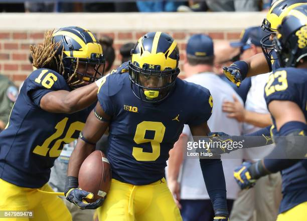 Donovan PeoplesJones of the Michigan Wolverines celebrates after running a 79 yard punt return for a touchdown during the third quarter of the game...