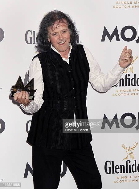 Donovan poses in front of the winners boards with his MOJO Maverick Award at the Glenfiddich Mojo Honours List 2011 awards ceremony at The Brewery on...