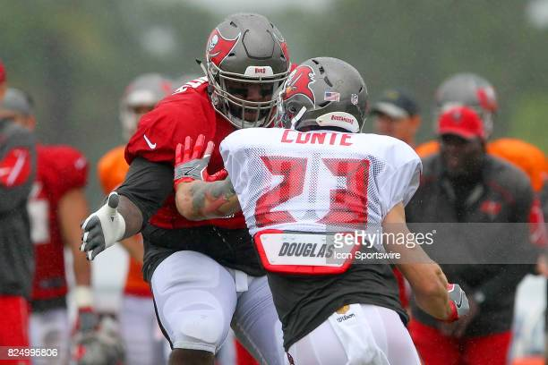 Donovan Smith sets up to block safety Chris Conte during the Tampa Bay Buccaneers Training Camp on July 31 2017 at One Buccaneer Place in Tampa...
